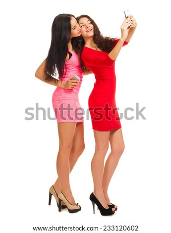 Two young girls with mobile phones isolated - stock photo