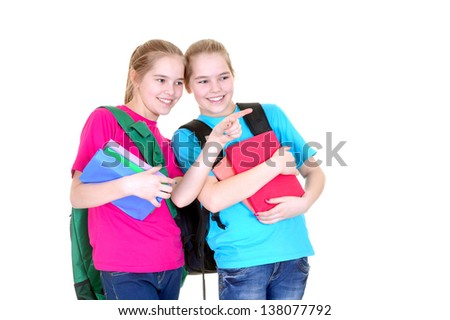 Two young girls with textbooks in colorful t-shirts on white background
