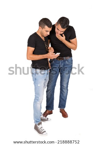 two young guys look at cell phone on a white background