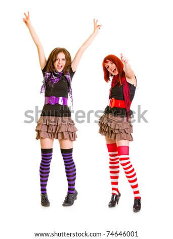 Two young happy girlfriends enjoying success isolated on white - stock photo