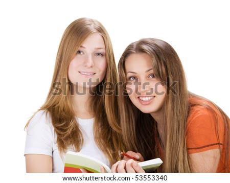 two young happy student girl work on laptop computer isolated on white