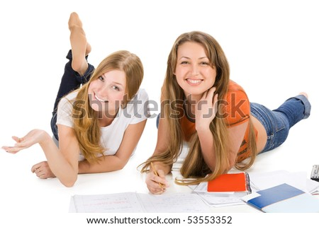 two young happy student girl work on laptop computer isolated on white - stock photo