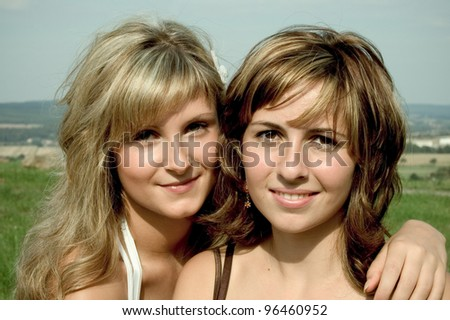 two young happy women - stock photo