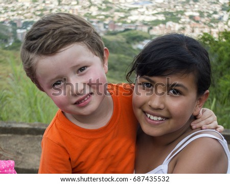 Two Young Kids happy outdoors.