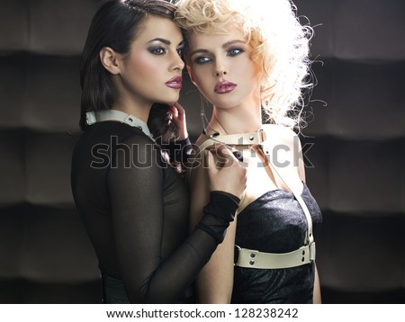 Two young ladies posing - stock photo