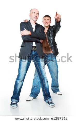 Two young men in jeans on a white background