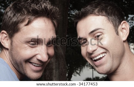 Two young men laughing - stock photo