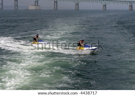 two young men on jet skiis - stock photo