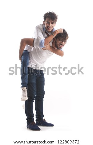 Two young men playing together isolate on white background