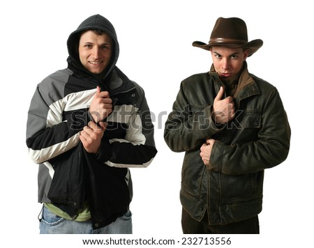 Two young men wearing winter clothes isolated on white