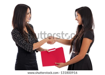 Two young mixed raced business women making a deal and shaking hands isolated on a white background - stock photo