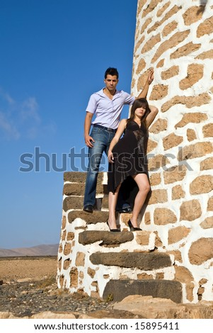 two young model posing on old windmill - stock photo
