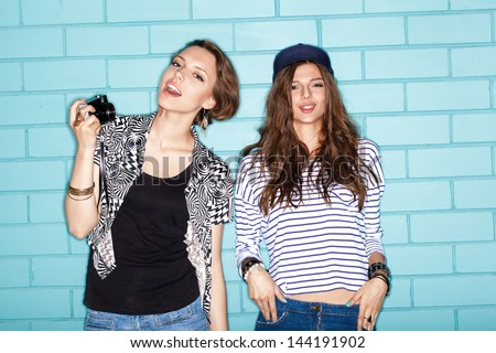 Two young naughty girlfriends having fun. Lifestyle - stock photo