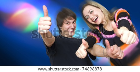 two young people dance in a night-club