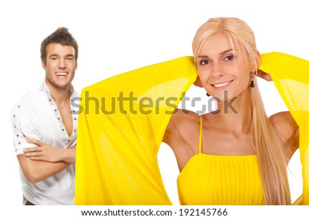Two young people: smiling blonde woman and dark-haired man against white background. - stock photo