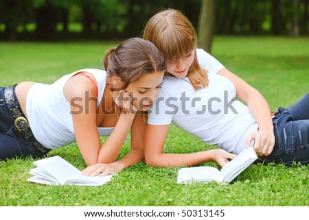 Two young pretty student girls in white t-shirt - stock photo