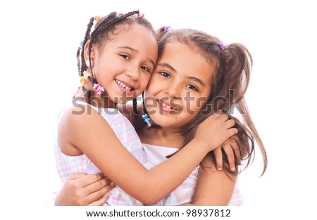 Two young sisters smiling - stock photo