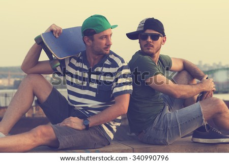 Two young skater having fun outdoors. - stock photo