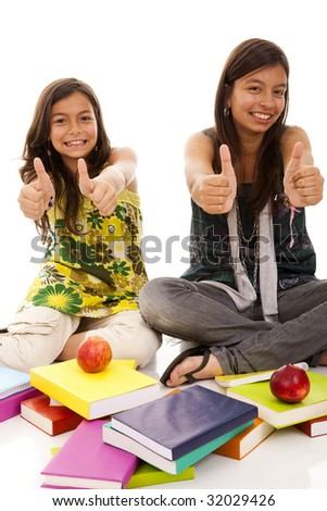 two young student sisters gesturing OK for going back to school - stock photo