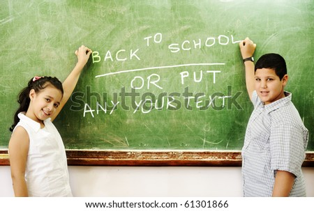 Two young students in class on board writing: great COPY-SPACE for you - just erase and write or draw whatever you want - stock photo