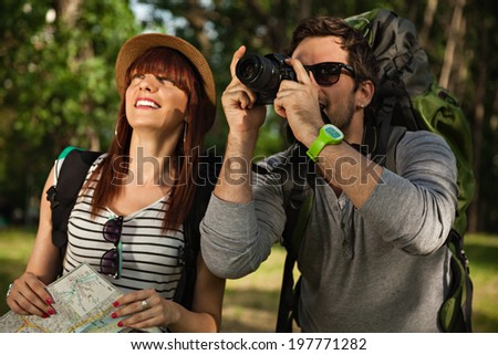 Two Young Tourists With Backpacks Enjoying In Nature.