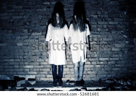 Two young vampire sisters - stock photo