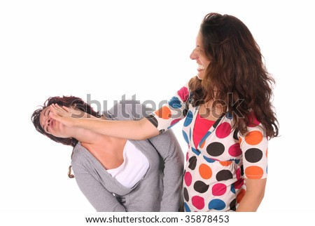 Two young woman fighting, a slapping in the face - stock photo