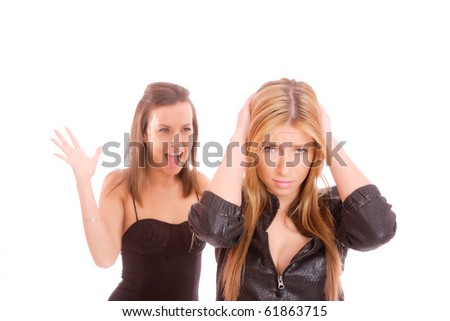 Two young woman fighting over a white background - stock photo