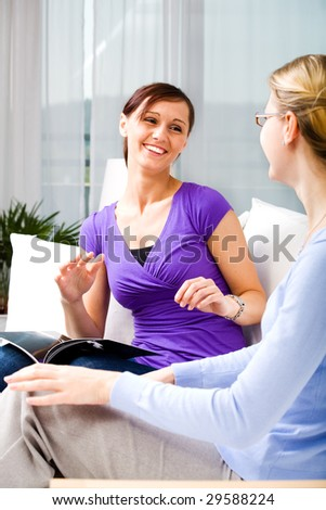 two young woman in the living room - stock photo