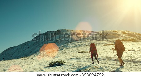 Two young women are traveling in the mountains.