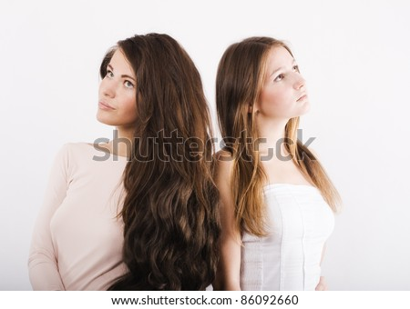 Two young women dream of. - stock photo