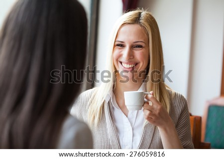Two young women in cafe