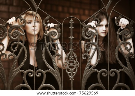 Two young women in depression - stock photo
