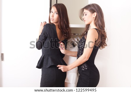 two young women in front of closet dress-up