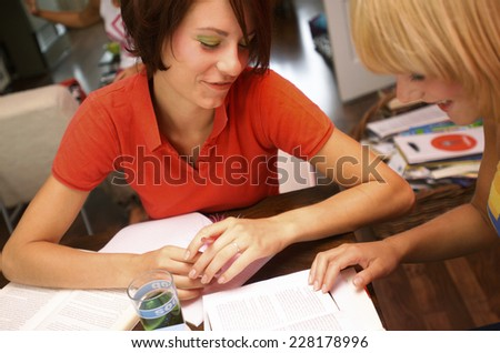 Two young women learning toegether - stock photo