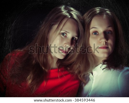 Two young women on a black background