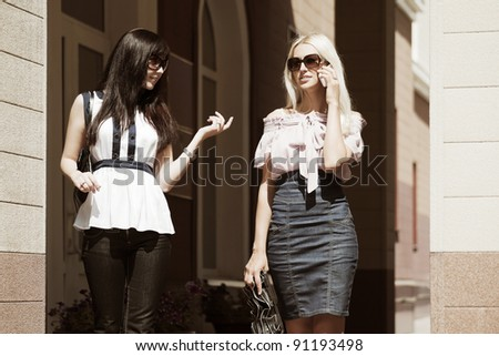 Two young women on a street