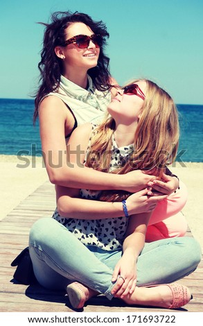 Two young women on a walk. Summer photo crafted style instagram - stock photo