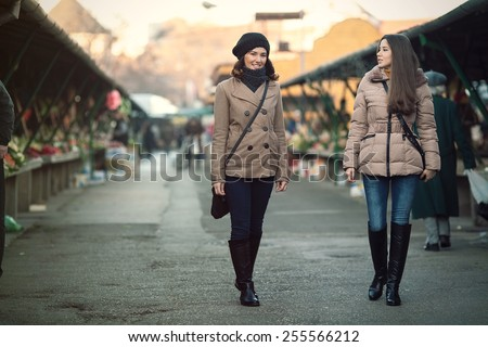 Two young women on farmer's market - stock photo