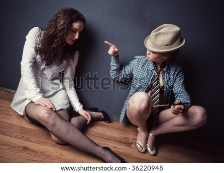 Two young women relationship. Wide angle view. - stock photo
