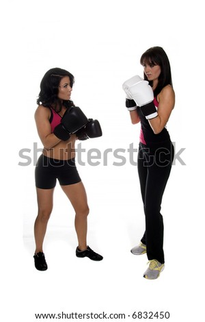 Two young women square off to box - stock photo