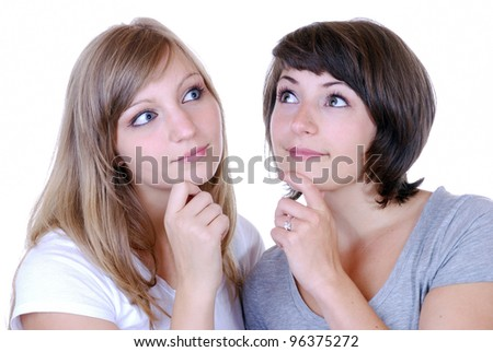 two young women thinking