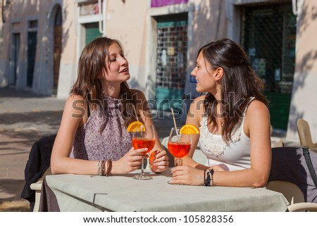 Two Young Women with a Cold Drink