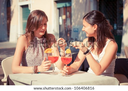 Two Young Women with a Cold Drink - stock photo