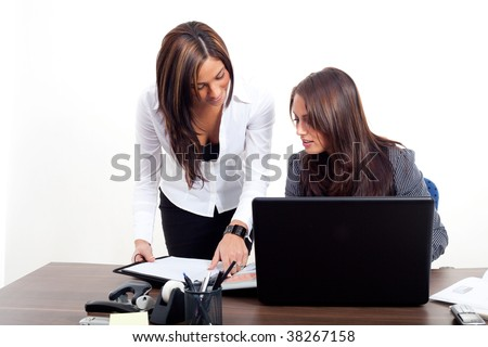 Two young women with a notebook - stock photo