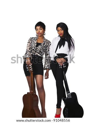 Two young women with guitars in vertical on white background - stock photo