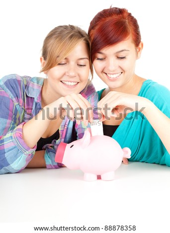 two young women with piggy bank