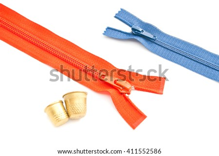 two zippers and thimbles on white background closeup