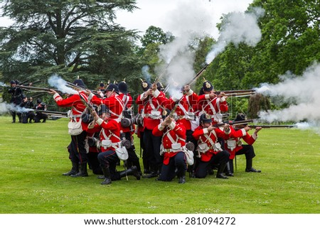 Tyntesfield, UK. 24th May 2015. A re-enactment troupe demonstrate in the Somerset countryside