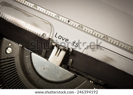 type writer with text Love is - stock photo